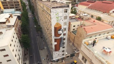 An Eleven-Story-Tall Tree Hugger Sprouts on the Side of a Building in Chile
