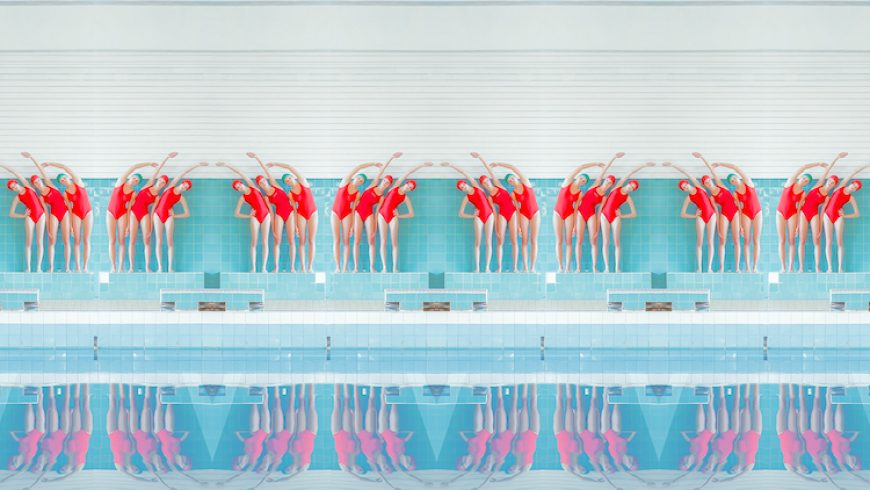 Visually Satisfying Photos Capture the Repetition and Symmetry of Swimming