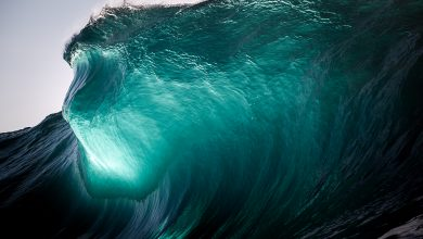 New Photographs of Waves Crashing Against the Setting Sun by Warren Keelan