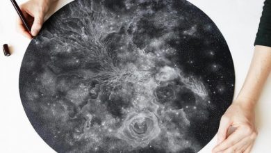Stippled black and white illustrations of star-packed galaxies by Petra Kostova