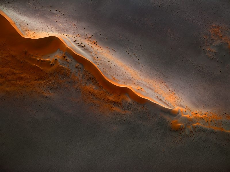 Striking aerial photographs of Namibia's arid landscape appear as abstract paintings