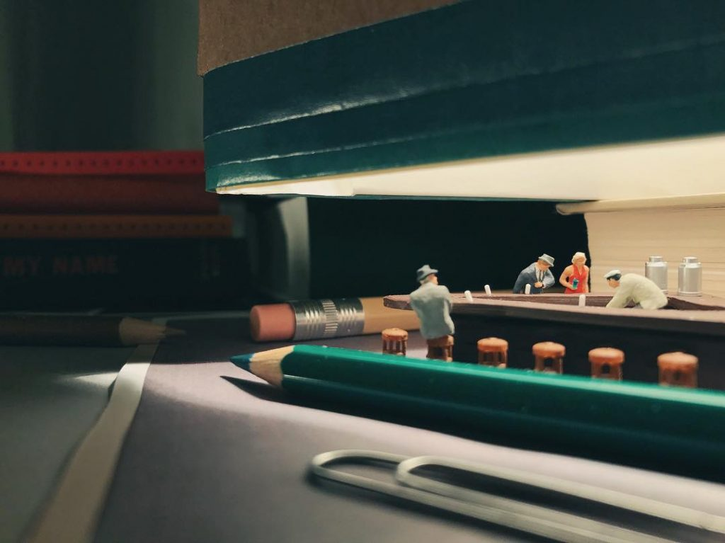 Miniature Scenes Set Amongst Office Supplies by Derrick Lin