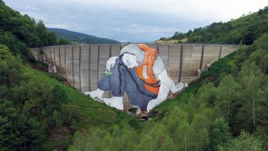 A Massive Mural by Ella & Pitr Depicts a Refugee Seeking Passage in France
