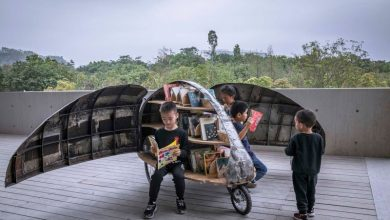 A retired bike-share bicycle upcycled to a beetle-shaped mobile library